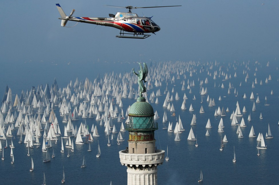 Sailing boats gather at the start of the Barcolana regatta in front of Trieste harbour