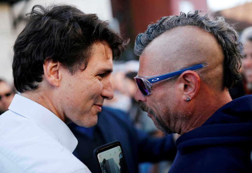 Liberal leader and Canadian Prime Minister Justin Trudeau speaks with a voter during an election campaign visit to Richmond Hill near Toronto
