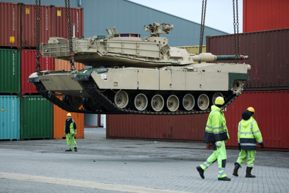 Tanks and support vehicles are transported at the military port in Vlissingen
