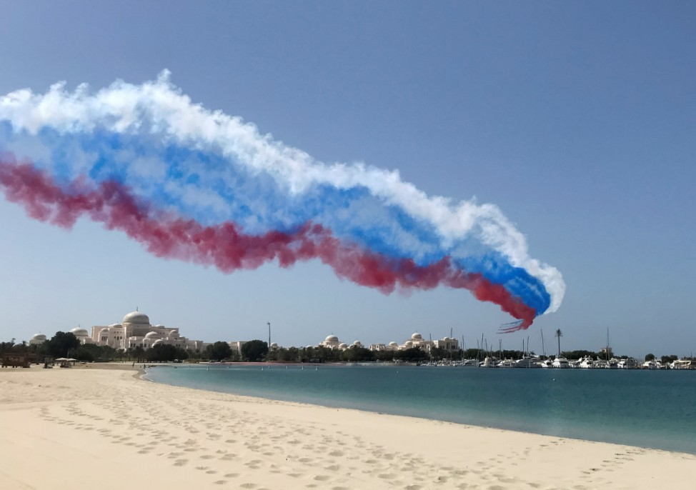 Aircrafts leave trails in colours of Russian flag during a visit of Russian President Vladimir Putin in Abu Dhabi