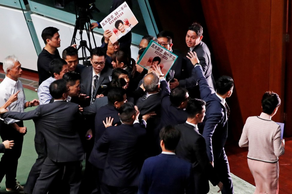 Hong Kong Chief Executive Carrie Lam leaves after her annual policy address was cancelled due to protests by pro-democracy lawmakers at the Legislative Council in Hong Kong
