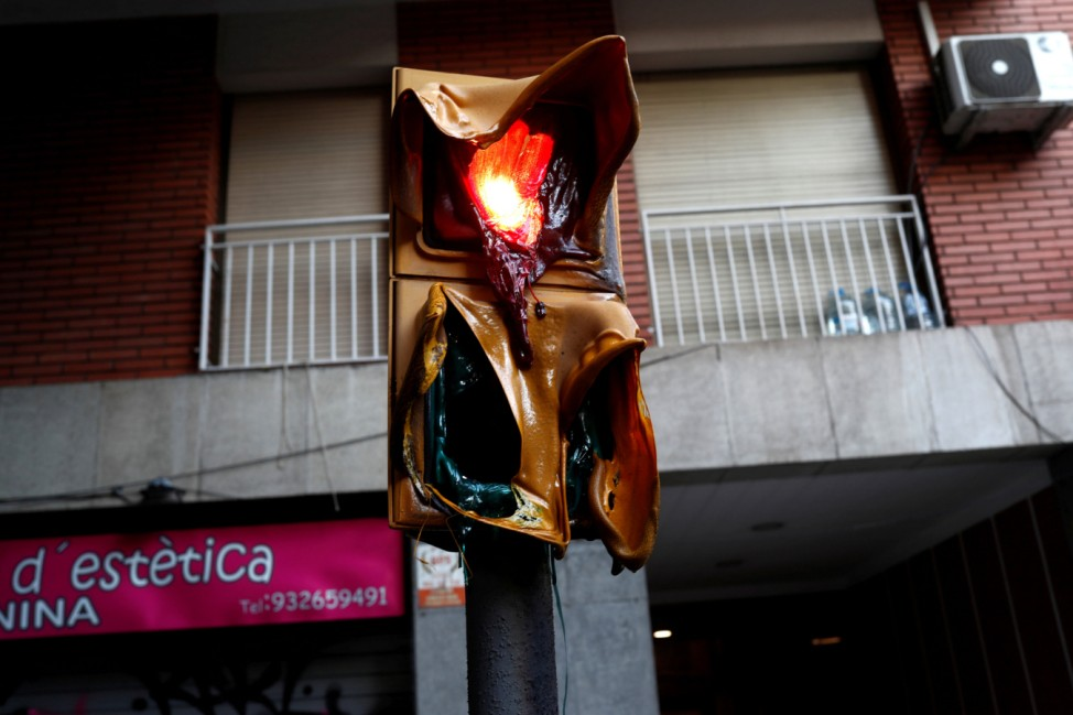 Melted traffic lights are seen after clashes of separatist demonstrators after a verdict in a trial over a banned independence referendum in Barcelona