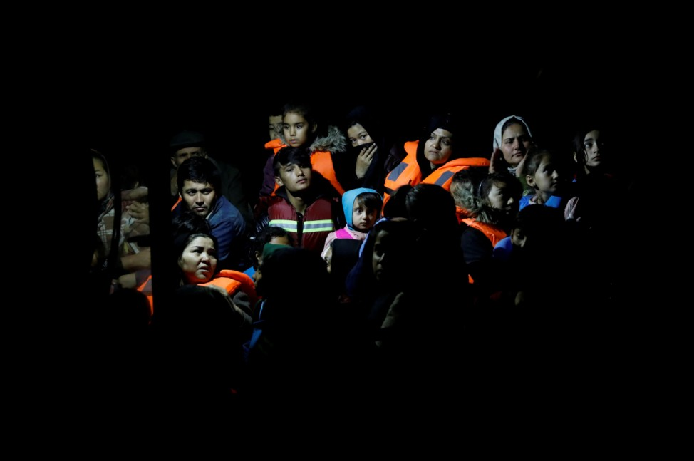 Migrants from Afghanistan, rescued at open sea, are seen onboard a Frontex patrol vessel, at the port of Skala Sikamias, on the island of Lesbos