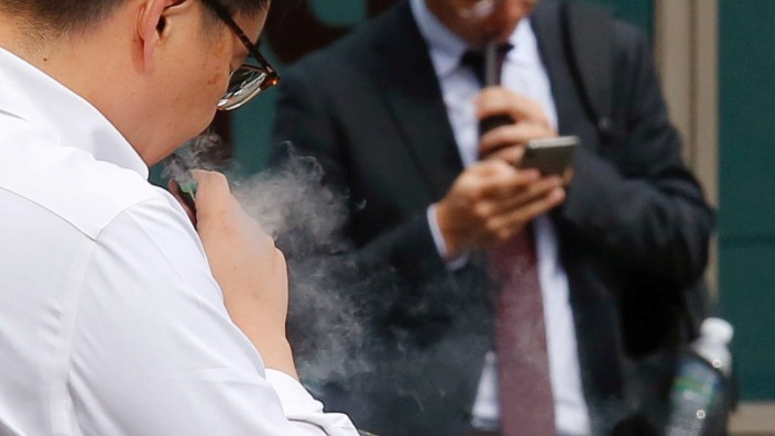 A man vapes in Seoul