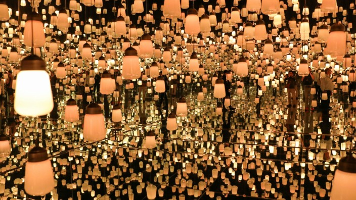 A view of the Forest of Resonating Lamps at teamLab Borderless exhibit at the MORI Building Digital Art Museum in Tokyo