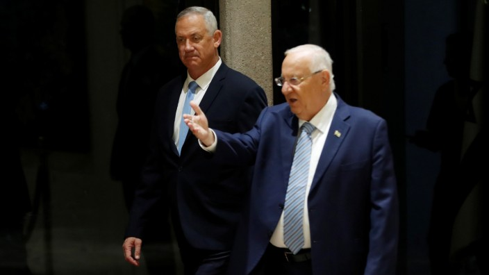 Israeli President Reuven Rivlin and Benny Gantz, leader of Blue and White party, arrive to a nomination ceremony at the President's residency in Jerusalem