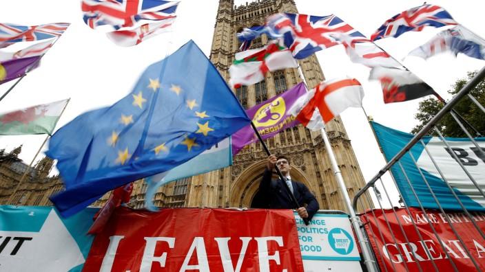 FILE PHOTO: An anti-Brexit protester waves an EU flag outside the Houses ofParliamentin London