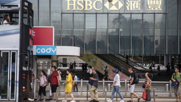 September 17, 2019, Hong Kong, China: Pedestrians walk past a British multinational banking and financial services holdi