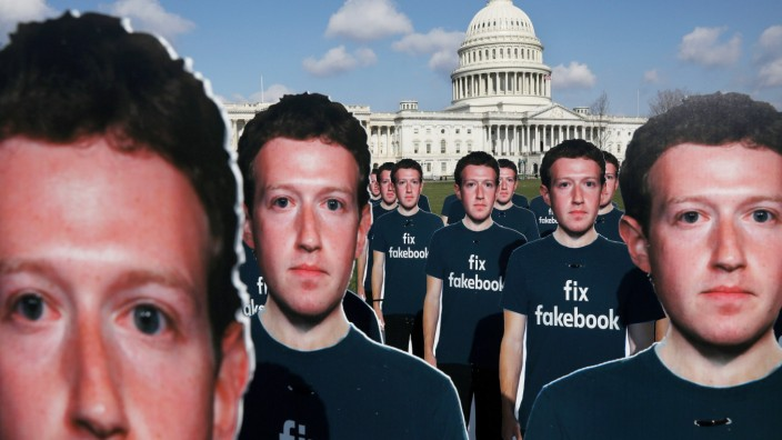 Protesters from Avaaz.org set up dozens of cardboard cut-outs of Facebook CEO Mark Zuckerberg outside of the U.S. Capitol Building in Washington