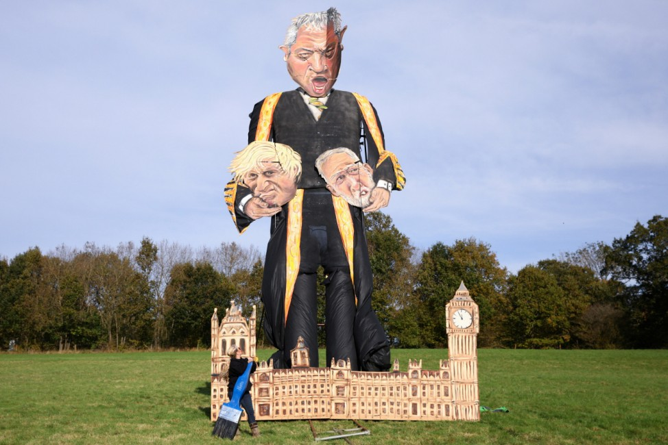 Andrea Deans, author of the 11-metre effigy of Britain's Speaker of the House of Commons John Bercow, poses after her piece was unveiled today, ahead of the Edenbridge Bonfire Celebrations, in Edenbridge