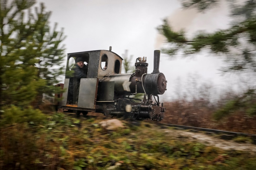 A home-made steam train, designed by Pavel Chilin, rides on a make-shift railway across country house neighborhood in the settlement of Ulyanovka in Leningrad region
