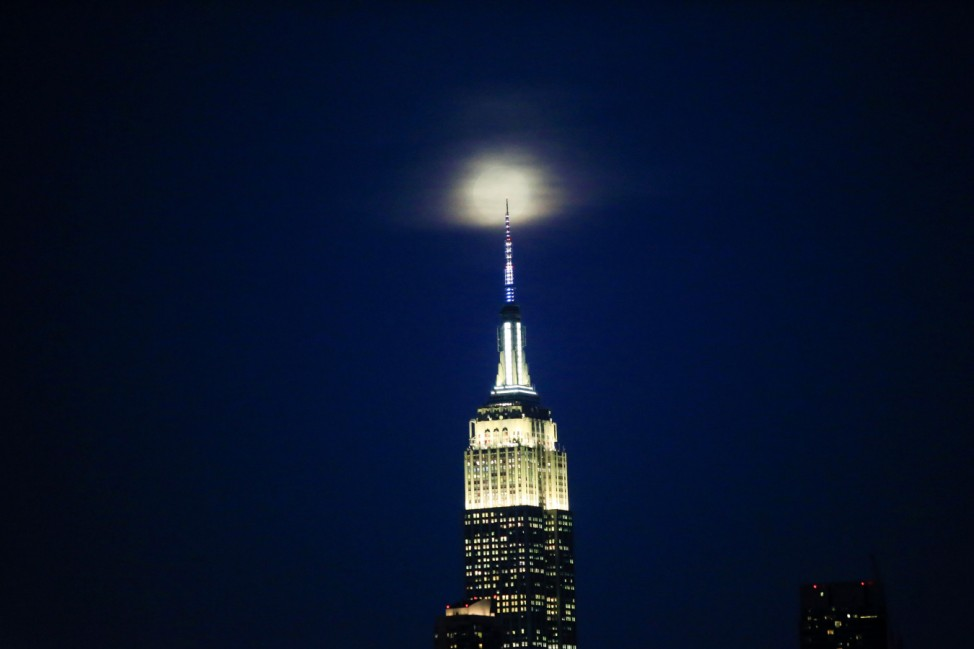 The 'Worm moon', the last Supermoon sighting of 2019, rises over the Empire State Building in New York City