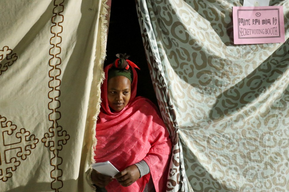 Birhannesh Chilota, 30, a housewife, comes out of the secret voting booth after casting a vote, during the Sidama autonomy referendum in Hawassa