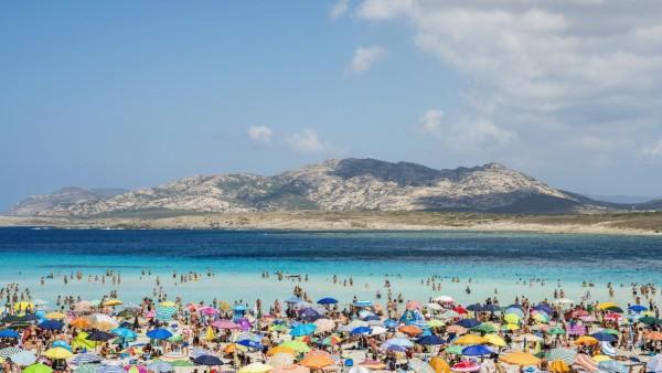 Tourists Enjoying The Turquoise Waters Of Famous Pelosa Beach; Stintino, Sardinia, Italy PUBLICATIONxINxGERxSUIxAUTxONL