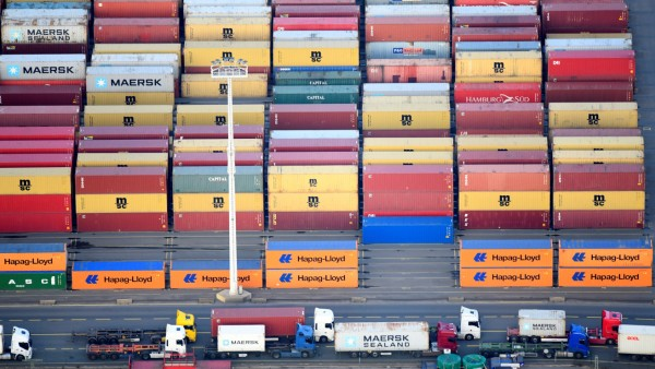 Containers of Maersk, MSC and Hapag-Lloyd are seen at a terminal in the port of Hamburg