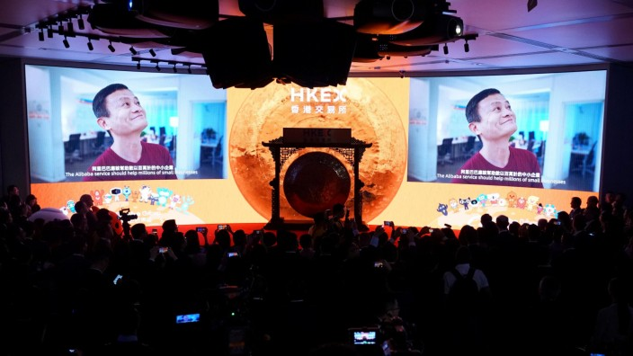 Alibaba's co-founder Jack Ma is seen on the screen at Alibaba Group's listing ceremony at the Hong Kong Stock Exchange (HKEX) in Hong Kong