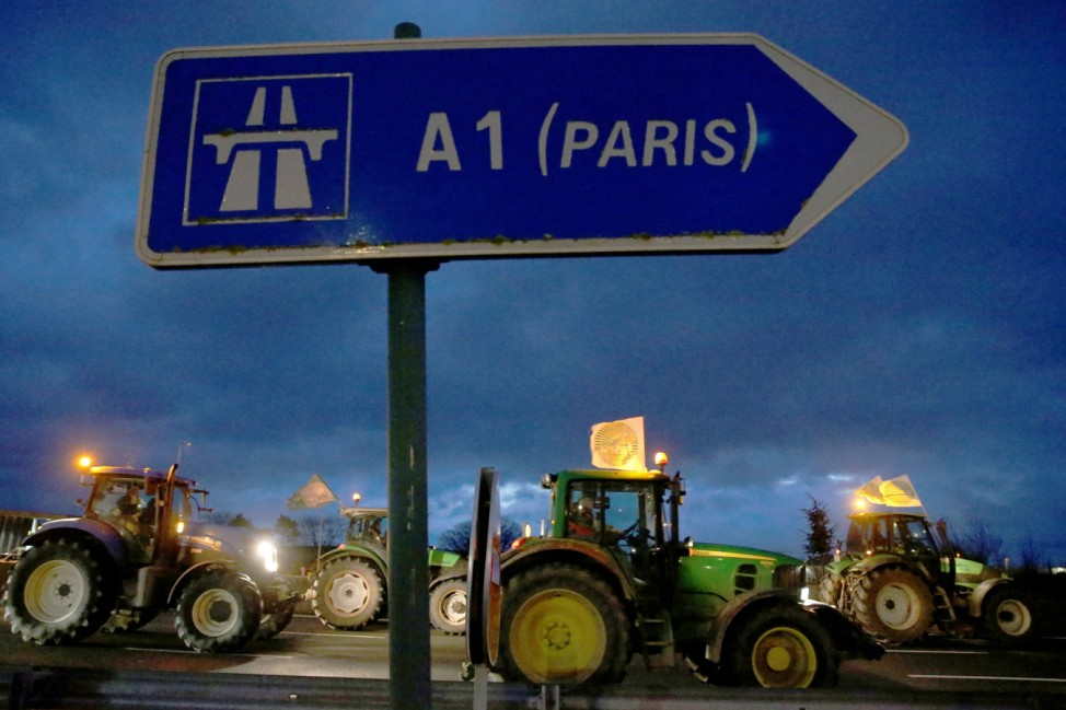 French farmers drive on the A1 Lille-Paris motorway during a protest near Vemars