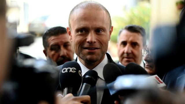FILE PHOTO: Maltese Prime Minister Joseph Muscat speaks to the media as he leaves a hotel in Valletta