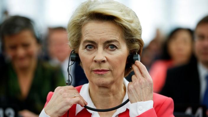 European Commission President-elect von der Leyen adjusts her earphones at the European Parliament in Strasbourg