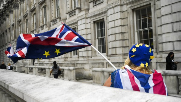 July 30 2019 London United Kingdom An anti Brexit demonstrator waves an EU and a Union flag as M