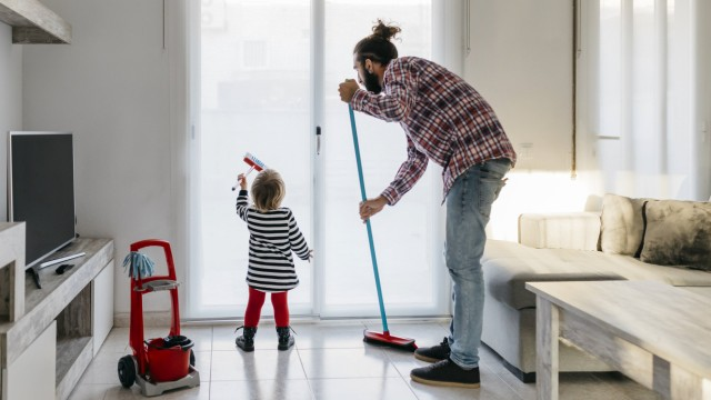 Father and little daughter cleaning the living room together model released Symbolfoto property rele
