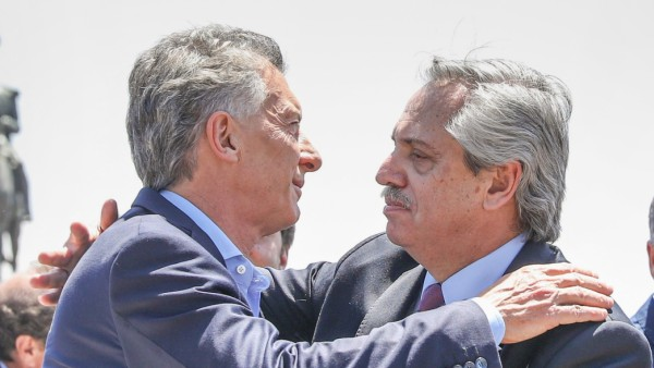 Argentina's outgoing president Mauricio Macri and President-elect Alberto Fernandez embracing during a mass held at Lujan, in Buenos Aires