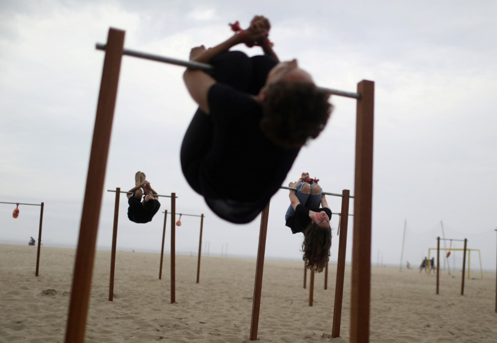 Activists of the  NGO Rio de Paz perform being tortured on an instrument called pau-de-arara (parrot's perch), used during the dictatorship, during the Human Rights day in Copacabana beach in Rio de Janeiro