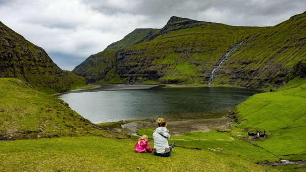 Denmark Faroe islands Streymoy Woman with her daughter looking to fjord of Saksun model released