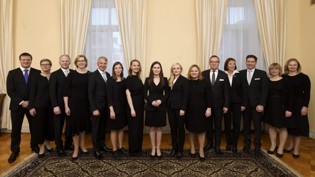 Finland's Prime Minister Sanna Marin and the ministers of the new Finnish government pose for a family photo in Helsinki