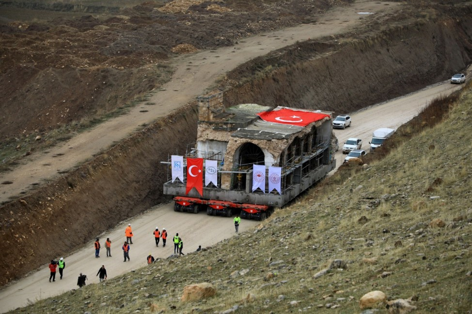 Er Rizk Mosque from the 15th century is transported from the ancient town of Hasankeyf by the Tigris river, which will be significantly submerged by the Ilisu dam, to the new Hasankeyf