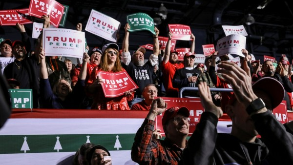 Supporters react while attending U.S. President Donald Trump's campaign rally in Battle Creek, Michigan