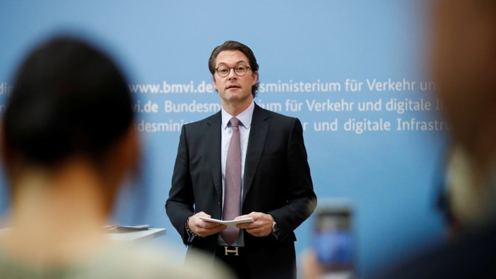 German Transport Minister Andreas Scheuer addresses a news conference in Berlin