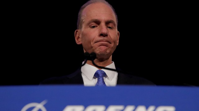 FILE PHOTO: Boeing Co Chief Executive Dennis Muilenburg pauses while speaking during a news conference at the annual shareholder meeting in Chicago