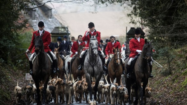 Members of the Old Surrey Burstow and West Kent Hunt ride with hounds during the annual Boxing Day hunt in Chiddingstone, Britain