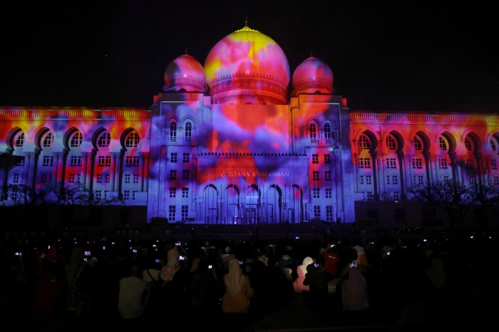 People look at 3D projection on Palace of Justice during LAMPU event in Putrajaya