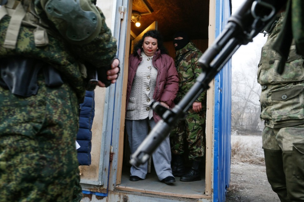 Servicemen of the separatist self-proclaimed republics stand guard before the exchange of prisoners of war in Donetsk region