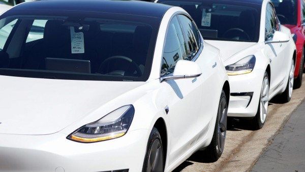 FILE PHOTO: A new Tesla Model 3 is shown at a delivery center on the last day of the company's third quarter, in San Diego