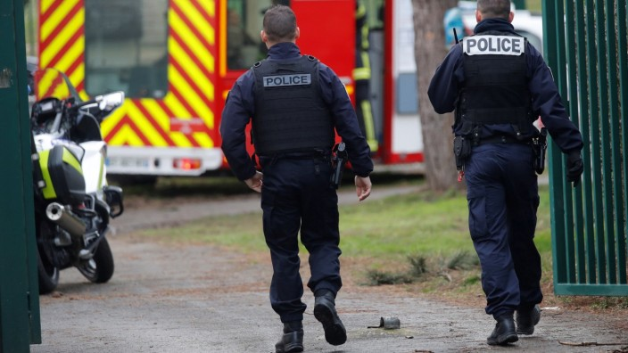 French police secure an area after a knife attack in a public park in Villejuif