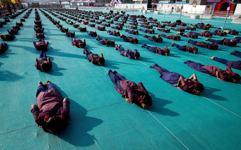 School children attend a yoga session in Ahmedabad