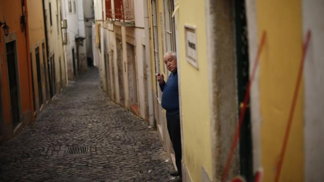 A man smokes at Alfama neighborhood in Lisbon