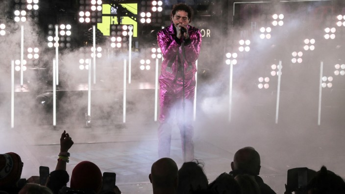 Post Malone performs during New Year's Eve celebrations in Times Square in the Manhattan borough of New York