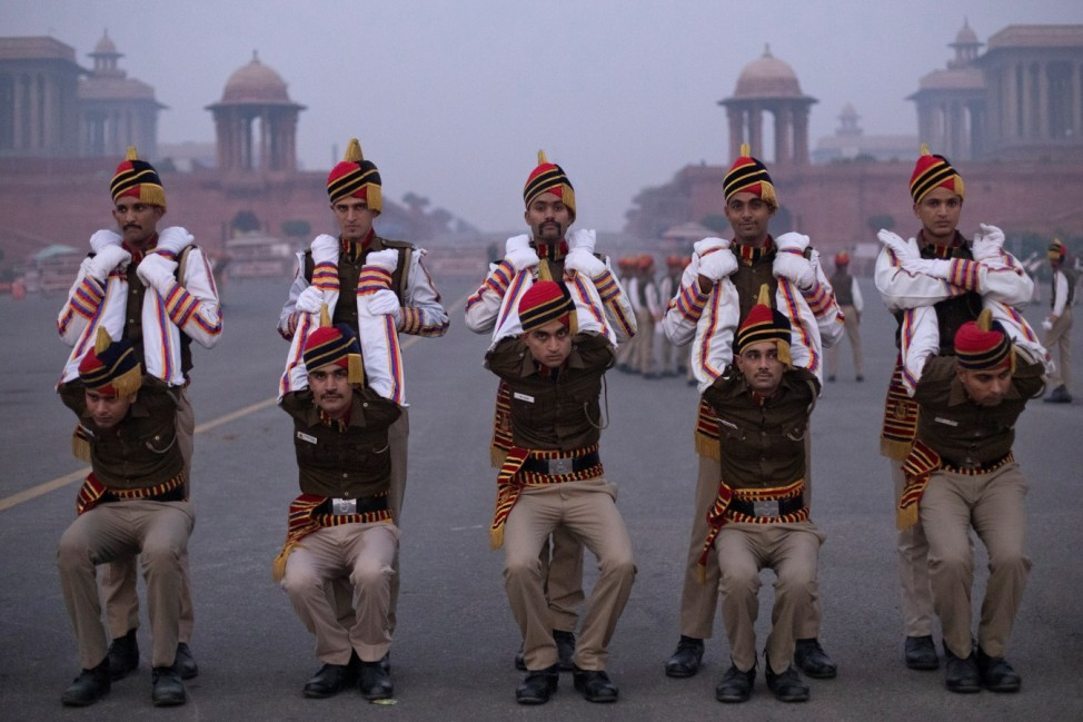 Members of Delhi Police stretch before the rehearsal for the Republic Day parade early morning in New Delhi