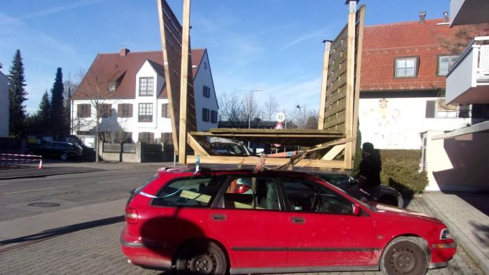 Ein Carport auf einem Autodach.