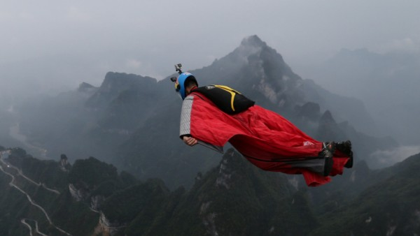 A competitor participates in a wingsuit flying contest in Zhangjiajie