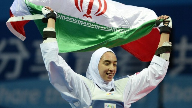 (140820) -- NANJING, Aug. 20, 2014 -- Kimia Alizadeh Zenoorin of Iran celebrates with holding her national flag after w