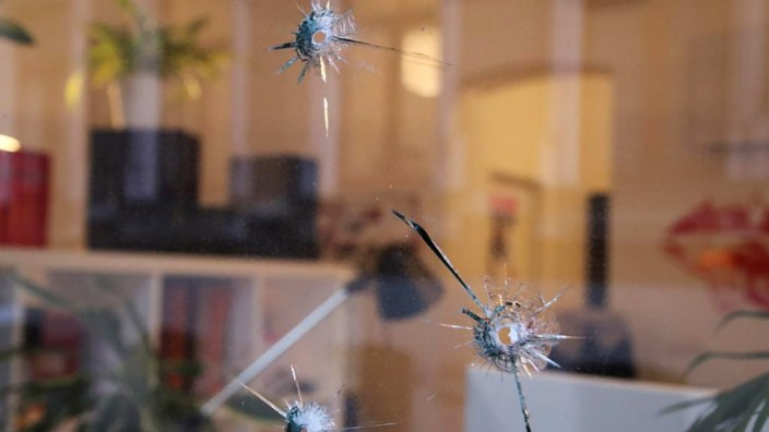 Bullet marks are seen on a window of the local office of the Social Democratic Party (SPD) Parliament Member Karamba Diaby in Halle