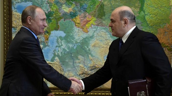 Russland: Präsident Wladimir Putin und Michail Mischustin