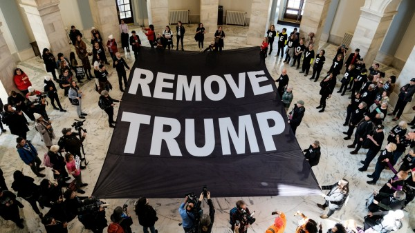 Activists call for the removal of U.S. President Donald Trump on Capitol Hill in Washington