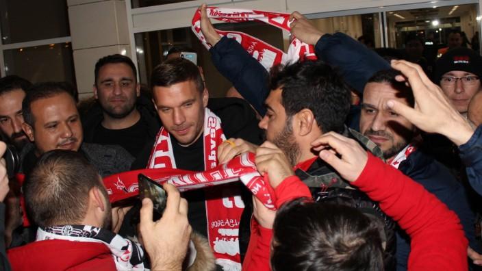 German striker Lukas Podolski reacts as he arrives at the Antalya Airport in Turkey on January 19, 2020. Podolski trave