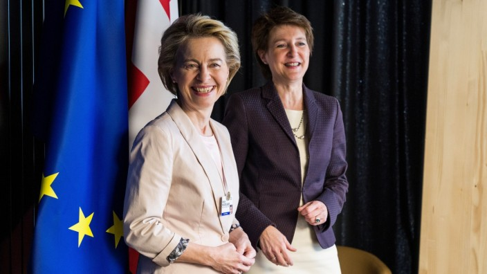 Swiss President Simonetta Sommaruga welcomes European Commission President Ursula von der Leyen on the sidelines of the World Economic Forum annual meeting in Davos